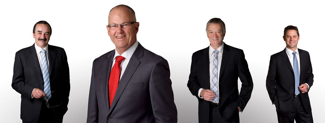 Four dashing life insurance advisors